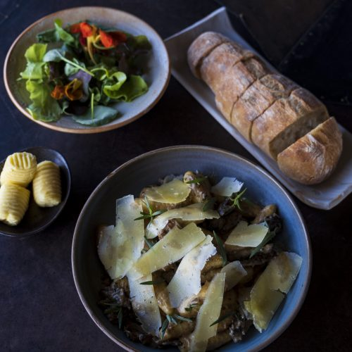 Gianni's mushroom gnocchi with bread roll, butter and salad