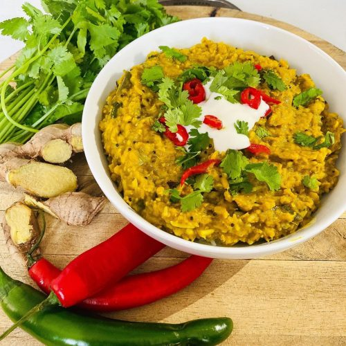 Dal curry in a bowl with ginger, chili and coriander